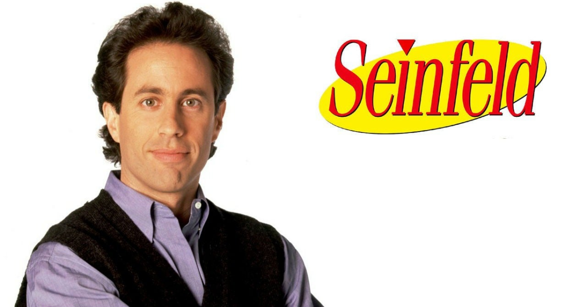 HD Picture of Jerry Seinfeld wearing sweater and full sleeves formal shirt