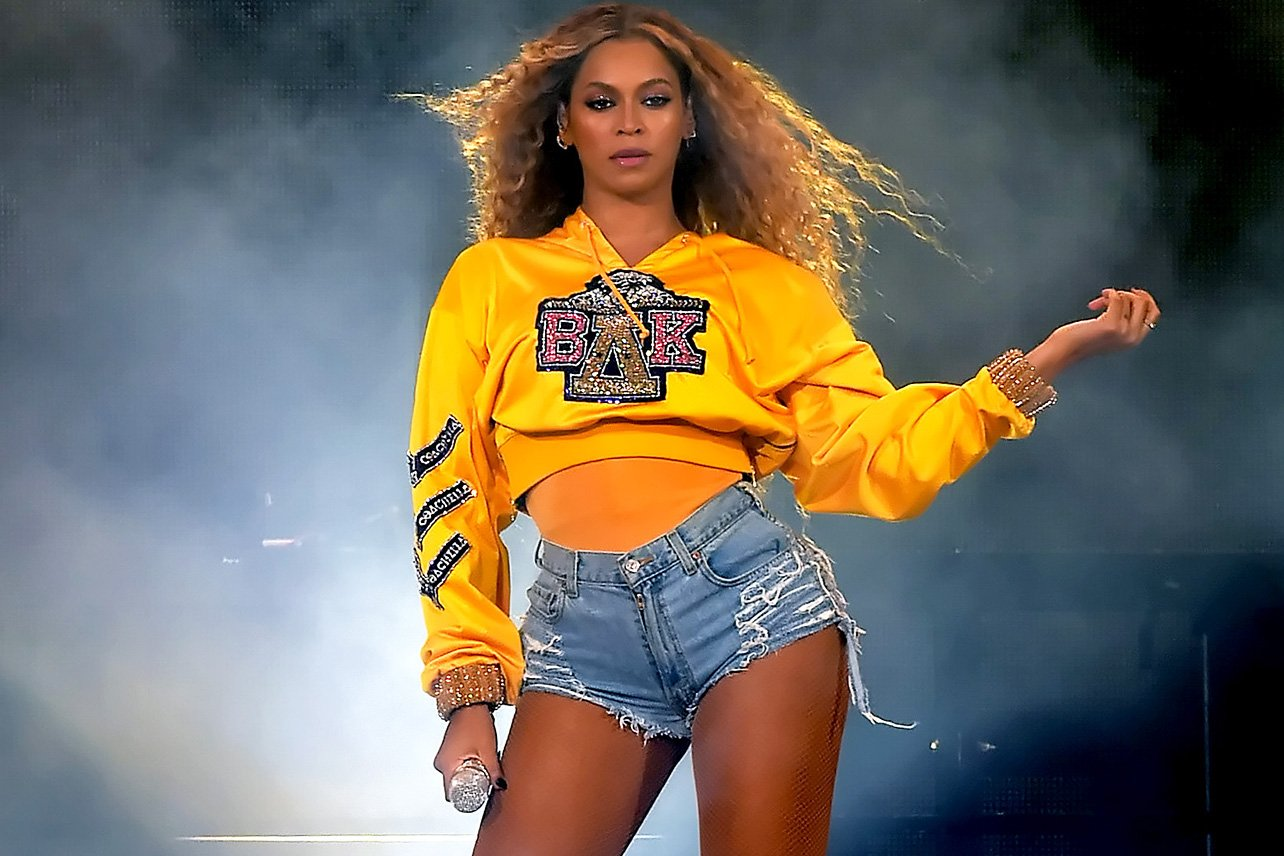 Beyonce Knowles Posing in Elegant Yellow Top
